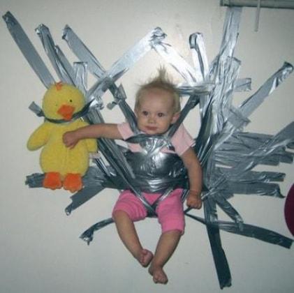 442_sabbiefu_abl-baby-taped-to-wall2
