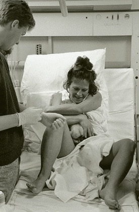 m8100208-mother_hugging_newborn_baby-spl