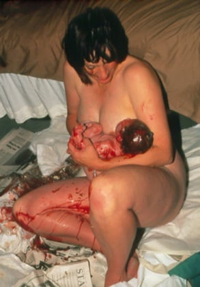 m8100188-natural_childbirth_mother_having_just_given_birth-spl