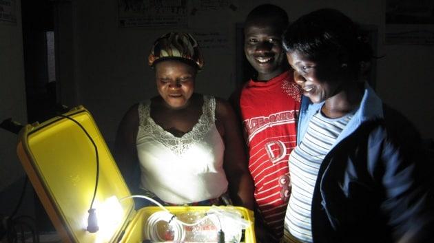 liberia-opening-suitcase-at-night