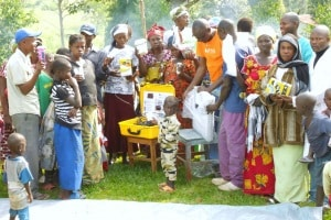 community-with-solar-suitcase-and-supplies.1500x1000