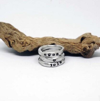 apertura-anelli-argento-unisex-personalizzati