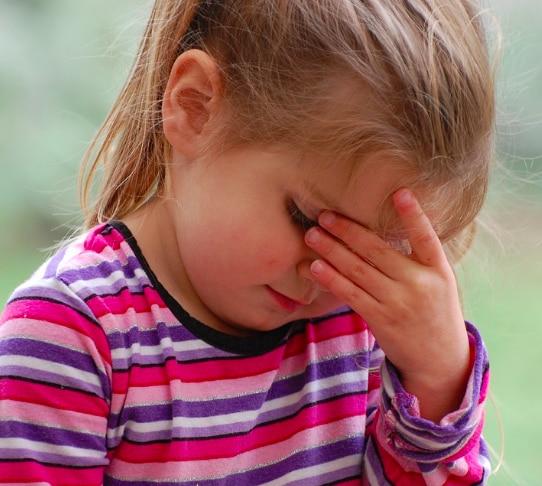 child_with_headache